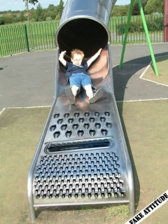 Kid On Grater Slide