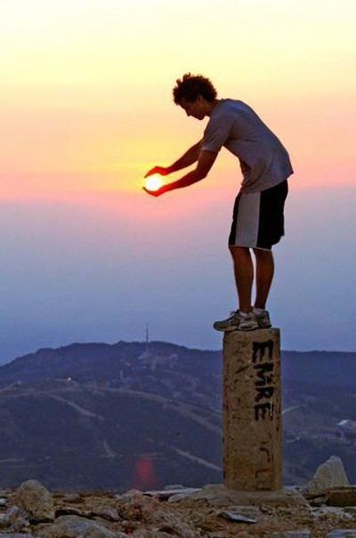 Boy holds the Sun