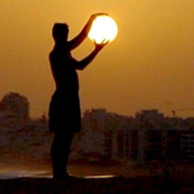 Man Holding Sun