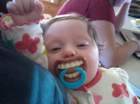 baby with pacifiers