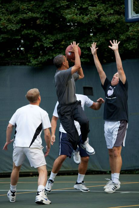 The President of The United States playing basketball.