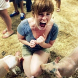 Funny photos - I guess she is scared of pigs