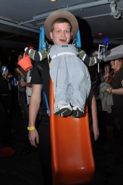 Halloween pictures - Dressed up as a boy sliding down a slide.