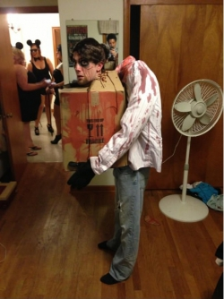 Halloween pictures - hurt his back for this costume