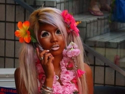 Funny photos - Over tanned Barbie