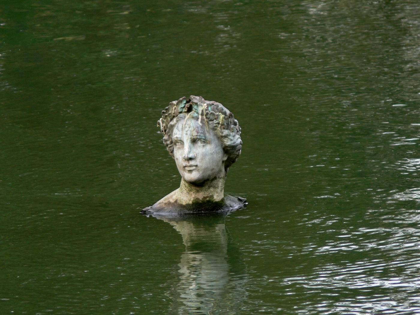 Statue in water